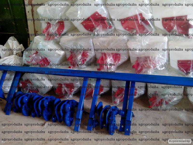 Система внисения минеральных удобрений на культиватор КРНВ
