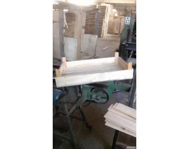 Ящики дерев'яні з шпону або з пиляної дошки